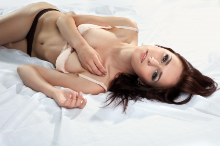 pretty sexy young woman on silk undress bra with desire Stock Photo
