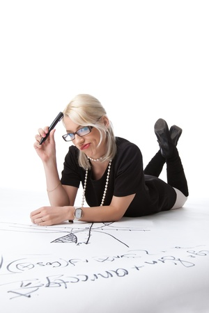 Cute blond woman thinking on drawing graph isolated Stock Photo - 13804178