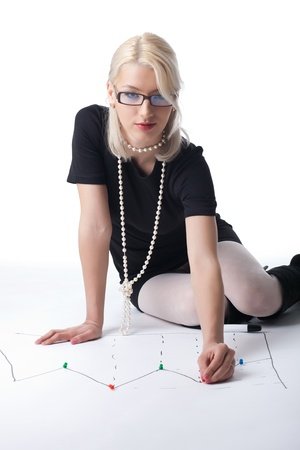 business blond woman pin point on graph isolated photo