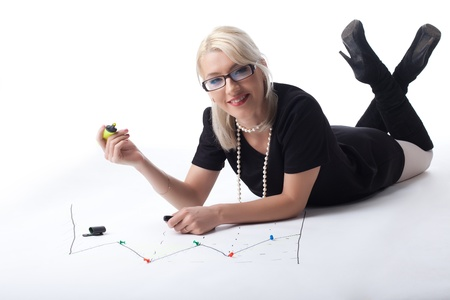 Cute blond business woman draw financial graph isolated Stock Photo - 13804207