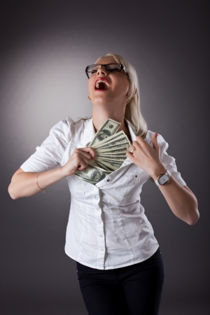 sexy blond businesswoman hide money under shirt photo
