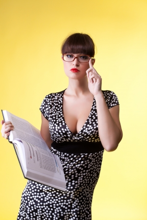 Beauty woman in attractive dress and glasses read smart book Stock Photo - 13825354