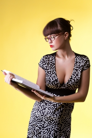 Beauty woman in attractive dress and glasses read smart book Stock Photo - 13825317