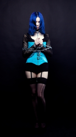 fetishes: Gothic girl with chain on black background Stock Photo