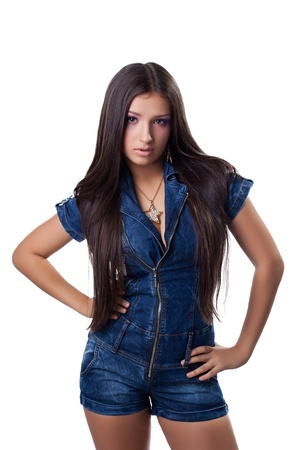 Beautiful young woman in overalls  Isolated on white photo