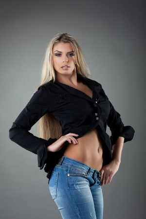 Blonde woman with long hair in black shirt and jeans photo