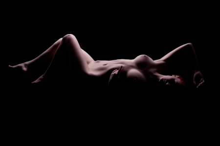 naked girl black hair: Pretty nude young woman posing in studio