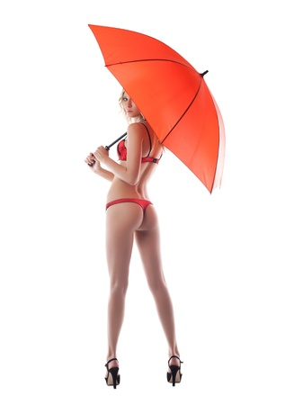 1 young woman only: Pretty young woman posing with umbrella  Isolated on white