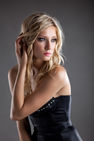 Young sexy woman in black leather corset photo