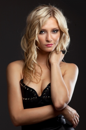 Studio portrait of pretty blonde woman in leather corset photo