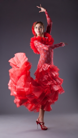 one woman dance flamenco in red costume  Standard-Bild