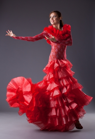 one woman gipsy flamenco dancer in studio photo