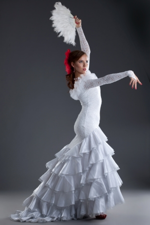 Full length portrait of woman performing flamenco photo