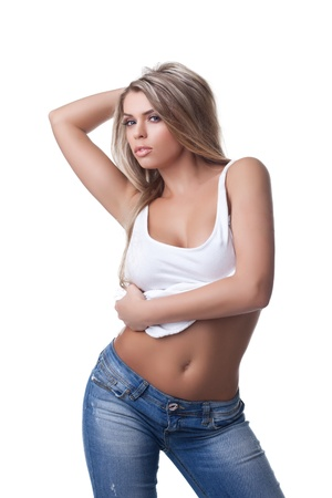 Sexual blonde woman in jeans  Isolated on white photo