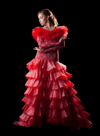 Pretty young woman like flamenco dancer in red oriental costume photo