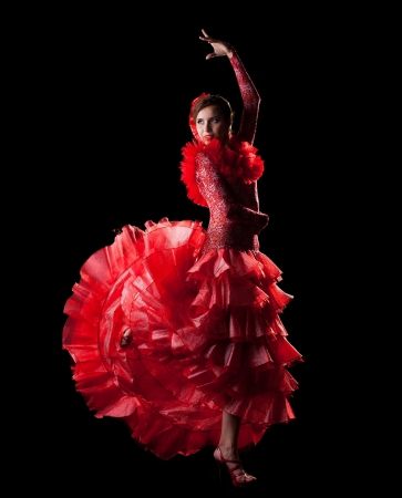 woman dance spain flamenco in red oriental costume in dark photo