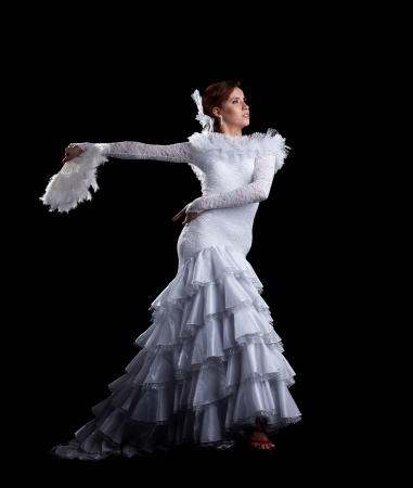 Young woman dance in white oriental flamenco costume Stock Photo - 14408579