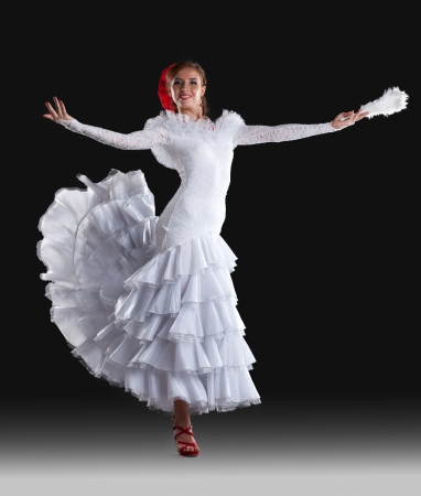 Beautiful Young dancer show white oriental flamenco costume photo