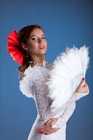 Young woman dance in white oriental flamenco costume photo