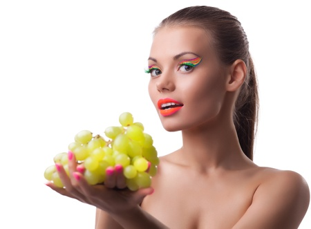 Pretty girl hold green grapes, ultra violet make-up photo