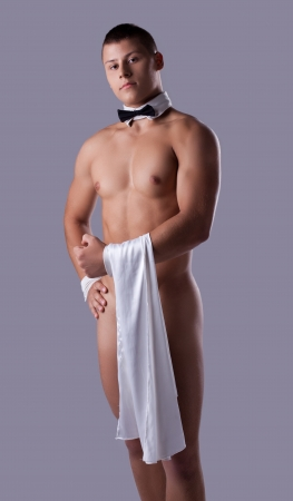 nude male: striptease man like waiter hold towel in hand Stock Photo