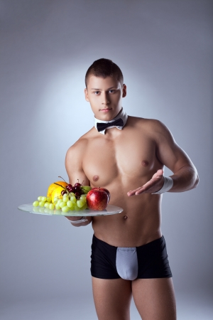 nude male: athletic man like striptease waiter offer fruits