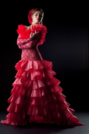 Full length portrait of flamenco dancer in red costume photo