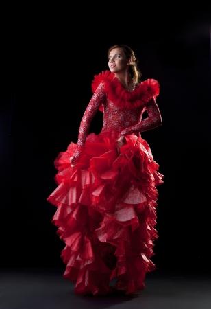 Full length portrait of flamenco dancer in red costume photo
