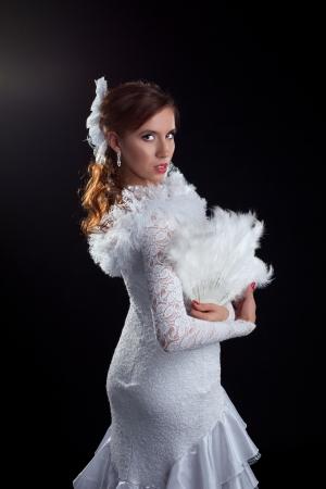 Studio portrait of dancer in white costume photo