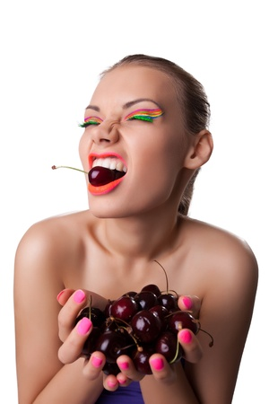 sexy food: Cute young funnygirl eat ripe cherry isolated