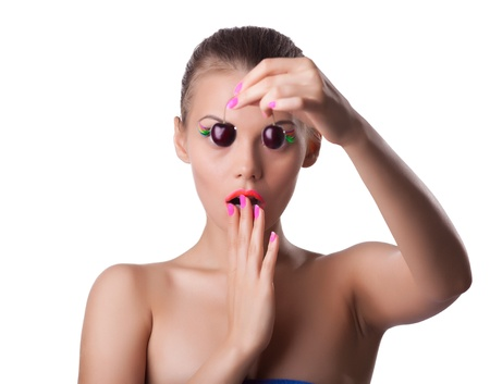 Scared beauty woman take ripe cherry with blindness isolated photo