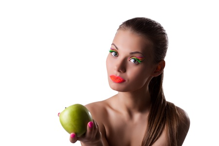 Cute woman offer green apple with glow make-up isolated photo