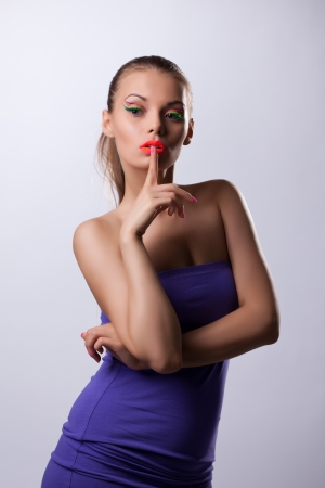 Young cute woman with ultraviolet make-up portrait photo