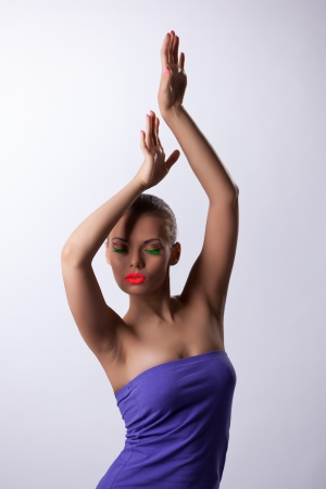 ultraviolet: Pretty girl posing in dance with glow ultraviolet make-up Stock Photo