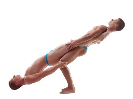 acrobat gymnast: two young athletic man posing in balance isolated Stock Photo
