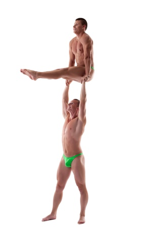 two men stand on heavy gymnastic performance isolated photo