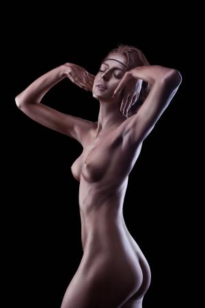 cuerpos desnudos: Mujer con cuerpo desnudo perfecto como estatua de metal de maquillaje