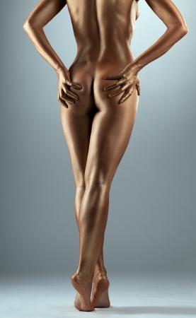 naked woman: Красота обнаженного тела женщины, как статуя металла с металлом макияжа Фото со стока