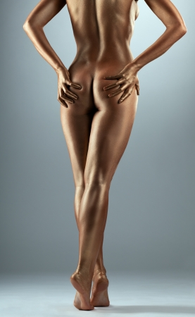 naked  body: Beauty naked woman body like metal statue with metal make-up Stock Photo