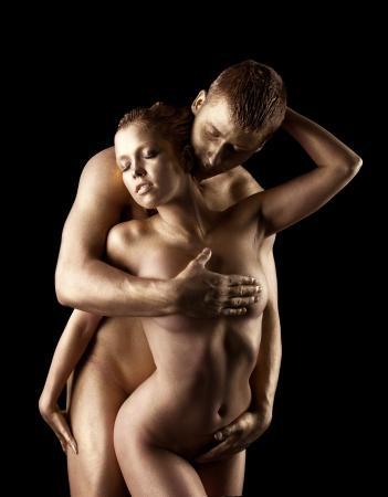 pareja desnuda: Belleza corporal mujer desnuda como la estatua de metal con metal de maquillaje