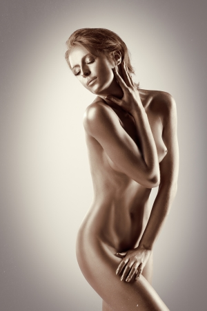 nude art model: Woman with perfect naked body like statue with metal make-up