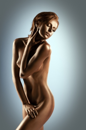 nude sport: Woman with perfect nude body like statue with metal make-up