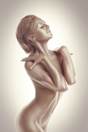 nude art model: Woman with perfect nude body like statue with metal make-up