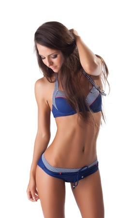 Young woman portrait in blue bikini and long hairs isolated