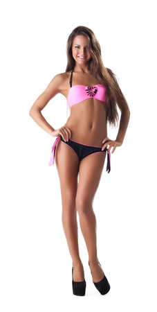 women in bikini: cute young girl in beach swimsuit stand isolated Stock Photo