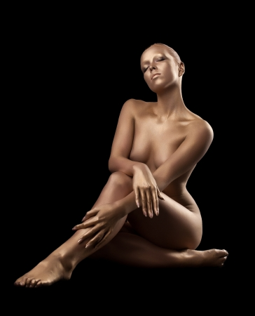 nude art model: Beauty naked woman body like metal statue with metal make-up Stock Photo