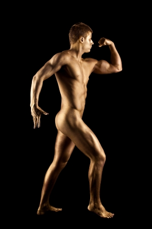 naked statue: Nude man show athletic body with metal skin statue Stock Photo