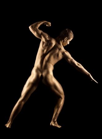 nude boy: Naked starke Mann posiert in metallische Haut Make-up Lizenzfreie Bilder
