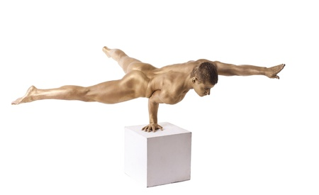 naked statue: Strong man posing nude stand on hand with metal skin