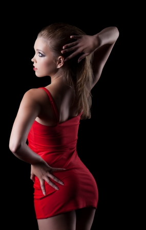 Beauty woman in red dress posing in dark Stock Photo - 14683335